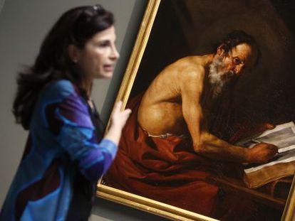 Restorer Almudena Sánchez, with 'Saint Jerome Writing,' newly attributed to José de Ribera.