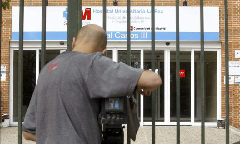 A news camera films outside the Carlos III hospital in Madrid.