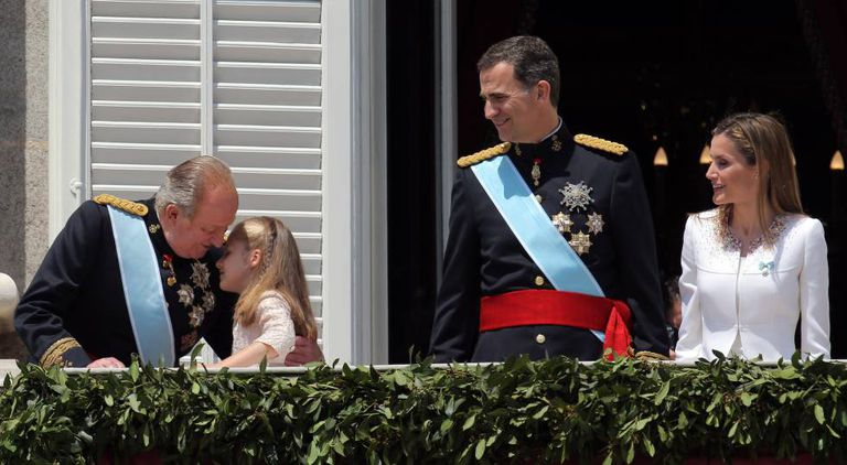 Juan Carlos embraces granddaughter Leonor on the day his son was crowned Felipe VI.