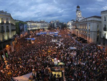 Madrid's Puerta de Sol throngs with protestors during the camp out last year.