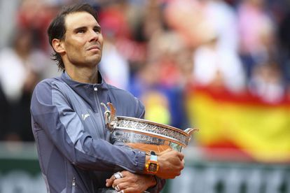 Rafael Nadal holding the Roland Garros cup.