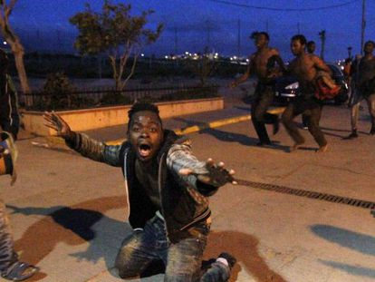 Successful migrants make their way to Melilla's immigrant holding center.