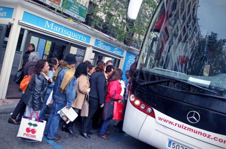 """Women boarding the """"caravan"""" in Madrid."""