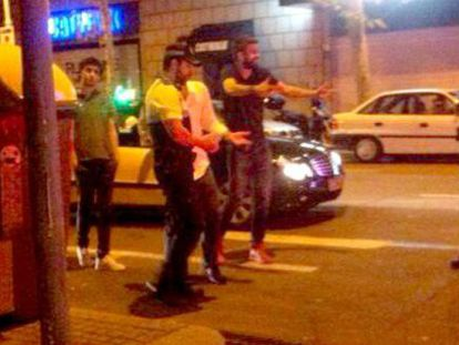 Piqué argues with Barcelona police.