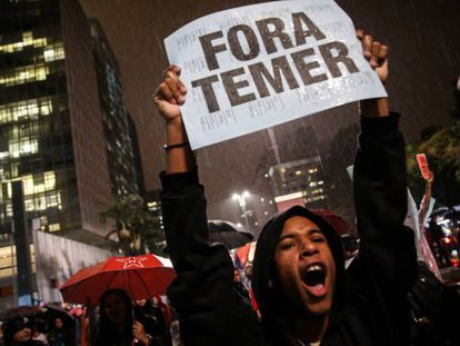 A protester calls for the resignation of Brazilian president Michel Temer in 2017.