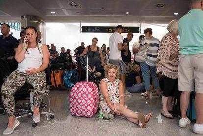 Thomas Cook passengers wait in Menorca airport.