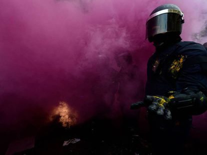 A riot police officer in Barcelona.