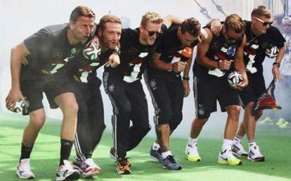 German players celebrating their win in Berlin.
