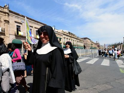 Nuns and other followers walk near the Cathedral in Morelia, Michoacán, ahead of the pope's visit.