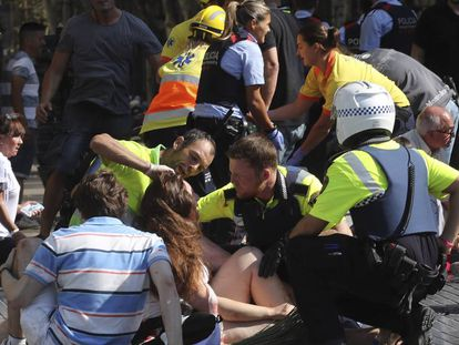 A victim being treated following the La Rambla attack.