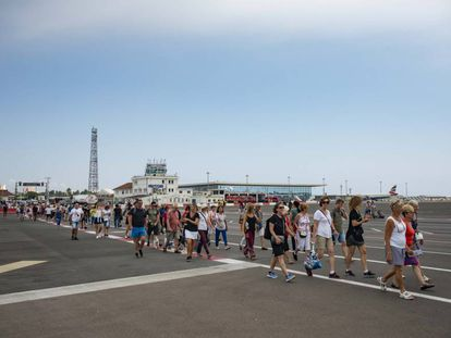 Visitors cross the airport of Gibraltar.