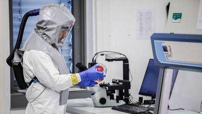 A lab technician handling a vaccine at Valneva Labs in Vienna (Austria).
