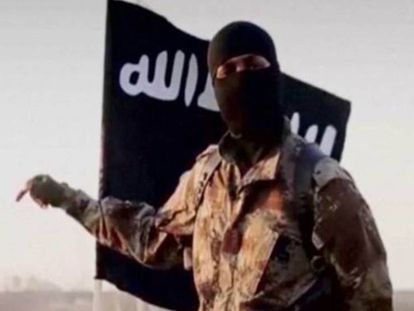 A hooded ISIS fighter.