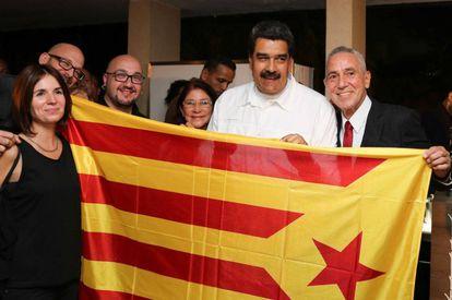 "Venezuela's President Nicolas Maduro with the Catalan ""estelada"" independence flag."