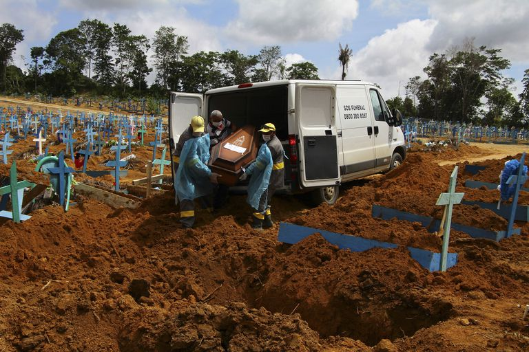 Cemetery workers burying a coronavirus victim in Manaus, Amazonas state, Brazil, on January 6.