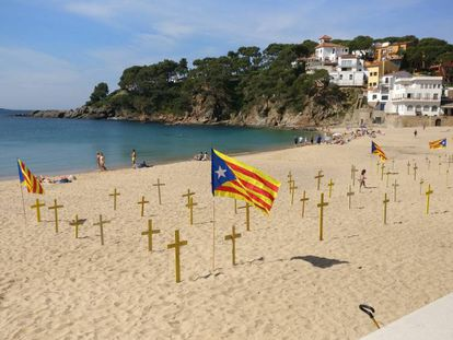 Crosses on a beach in Llafranc (Girona).