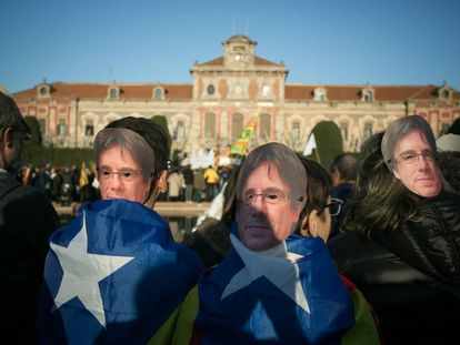 Wearing Puigdemont masks, separatists protested outside Catalan Parliament yesterday.