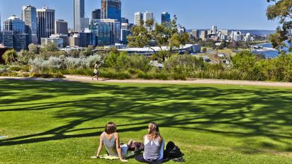 Two young people relax in Kings Park in Perth, Australia.