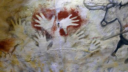Painted hands in the cave of Altamira.