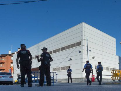 Officers outside the police station in Cornellà de Llobregat.