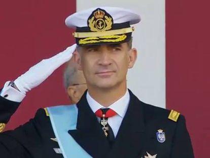 King Felipe salutes as the military parade passes.