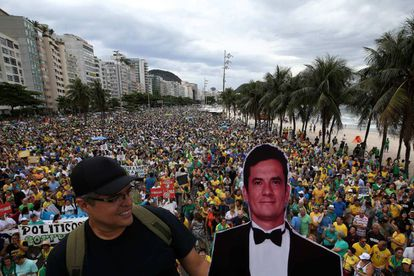 A demonstrator holds up a cardboard cutout of judge Sergio Moro.