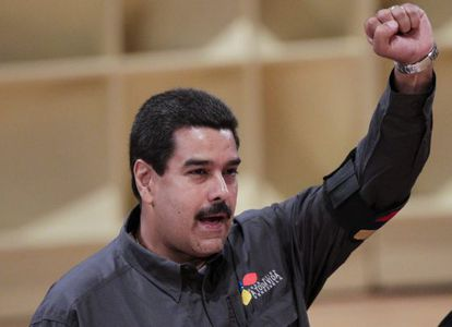 Interim President Nicolás Maduro salutes the crowd at the opening of Caracas Book Fair on Wednesday.