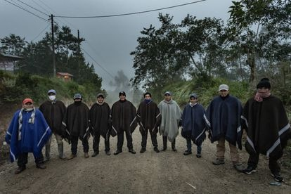Security team for Pedro Castillo outside the latter's home in Chugur, in the Cajamarca region of Peru.