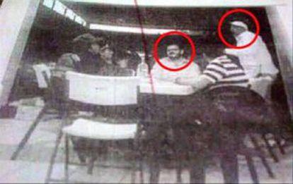 A photograph of Rodrigo Vallejo (sitting) and La Tuta (wearing hat)