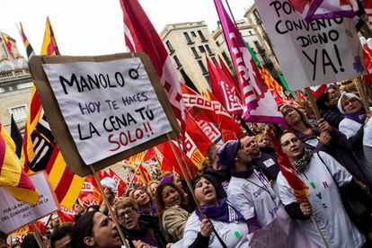 Women in Barcelona hold up a sign that reads