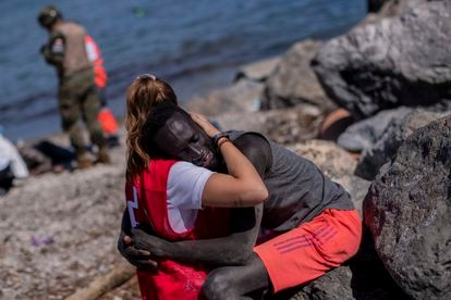 A migrant is comforted by a member of the Spanish Red Cross in Ceuta on Tuesday.