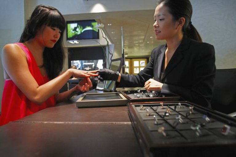A Chinese tourist tries on a ring at the Suárez jewelry store