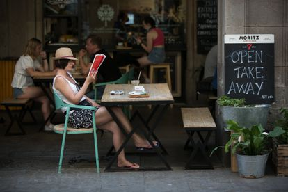 Customers at a sidewalk café in Barcelona's Plaza Real.