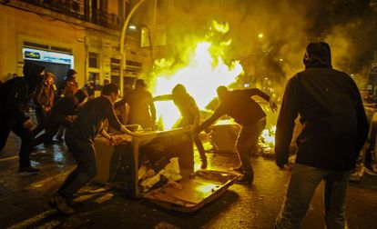 Protestors set a barricade on fire in Barcelona's Sants neighborhood.
