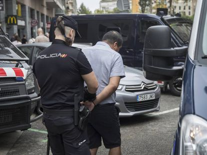 Officers from the Catalan and National Police force during a raid.