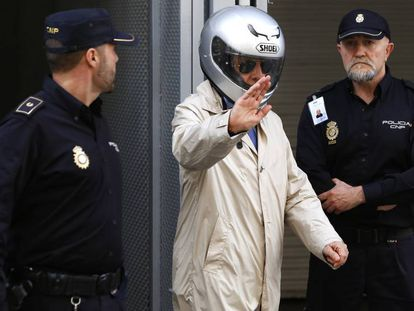 González Pacheco leaves court in a file photo from 2014.