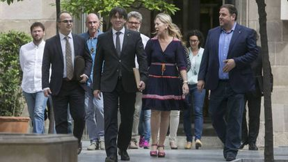Catalan Premier Carles Puigdemont leads fellow Catalan political leaders outside the regional congress on Monday.