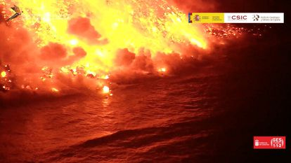 Steam rises as lava from the Cumbre Vieja volcano reaches the Atlantic Ocean off the island of La Palma on September 29, in an image captured by the Geological and Mining Institute of Spain.