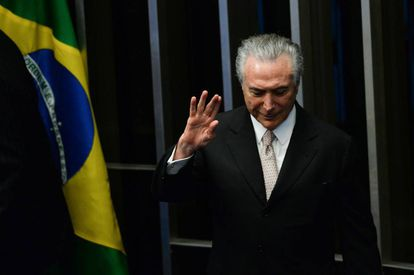 President Michel Temer waves as he takes office on Wednesday.
