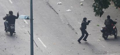 Armed civilians confront protestors.
