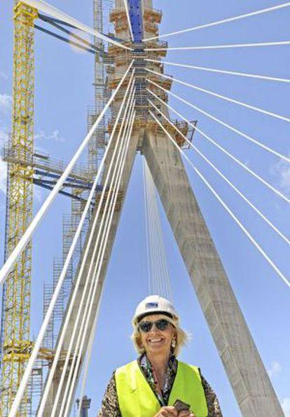 Cádiz Mayor Teófila Martínez poses in front of ongoing construction work on the city's new bridge.