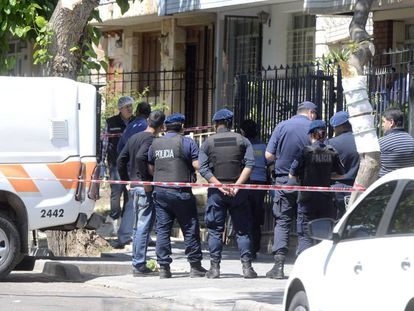 Police at the triple murder scene in Mendoza, Argentina.