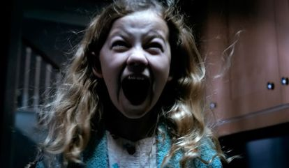 Youngster Megan Charpentier in a scene from Mama.