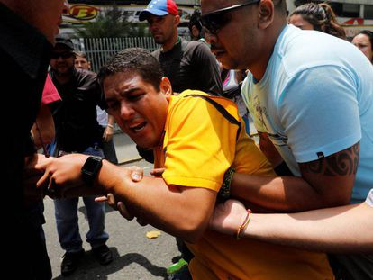 Opposition MP José Olivares (in yellow) of the Justice First party during protests on Thursday in Caracas.