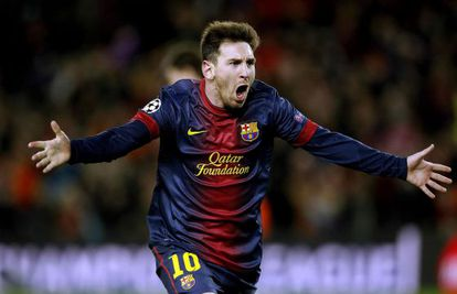 Barcelona's Leo Messi celebrates his and the team's second goal in the victory over AC Milan.