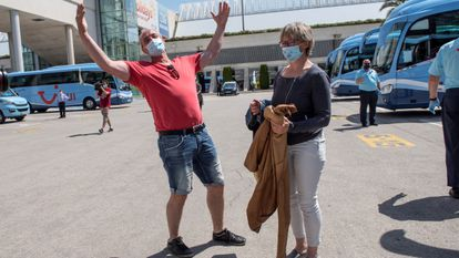A pair of German tourists arrive in Mallorca in Spain's Balearic Islands on Monday.
