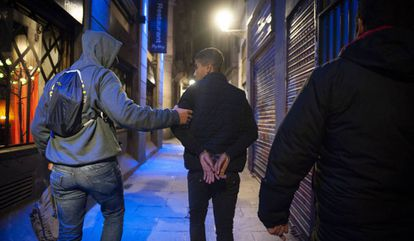 Plainclothes police officers make an arrest in Barcelona.