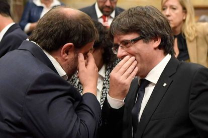 Catalan Premier Carles Puigdemont and his deputy Oriol Junqueras on Tuesday.