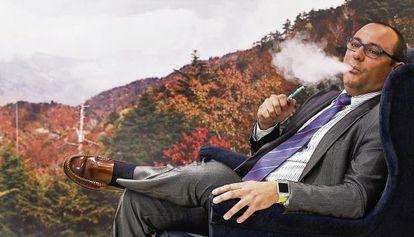 Manuel Muñoz, head of the Spanish National Electronic Cigarette Association, enjoys a vape.