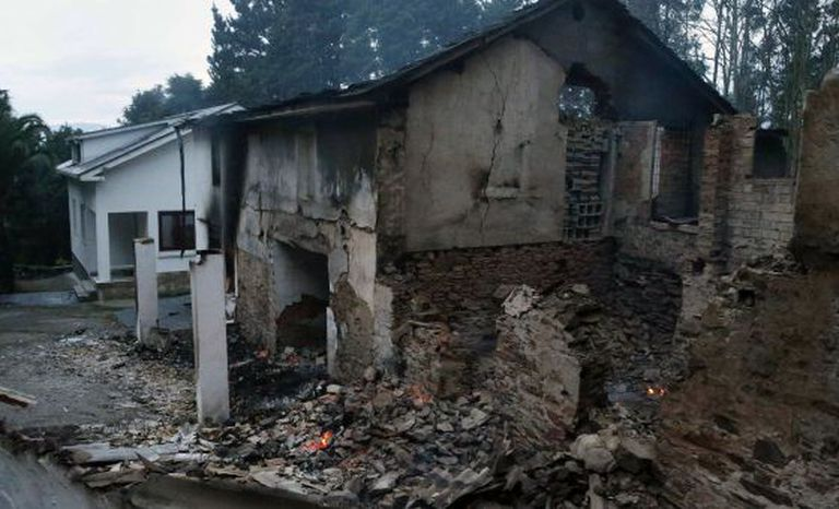 Fire-damaged homes in El Franco.